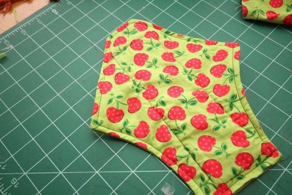 Fold open end in 1/2 inch and pin. Sew end closed. I have been doing double stitch on the end to reinforce.